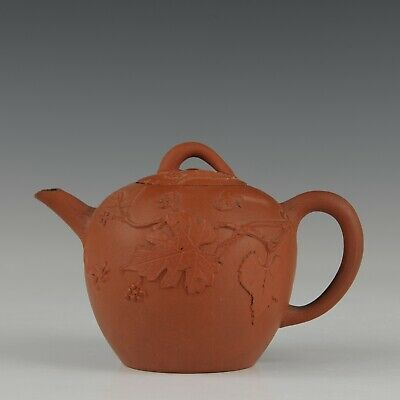 Nice relief decorated Yixing red clay teapot, squirrels, 18th century.