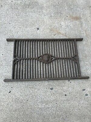 Antique cast-iron grate heavy with face  17.5 x 11.5