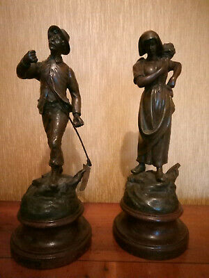 A pair of vintage patinated Spelter figures.on a plinth