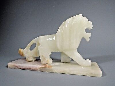 Fine Onyx Carved Stone Statue of a Prancing Snarling Lion ca. 20th century