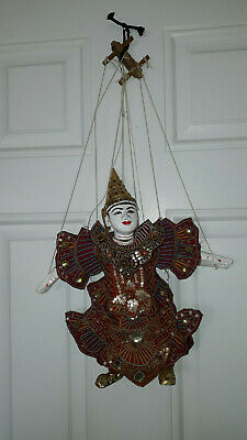 Retro Japanese traditional puppet with strings, decorative traditional clothes.