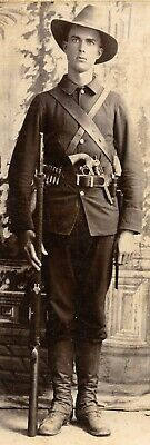 Spanish American War Soldier with his musket, colt, and bayonet in studio pose