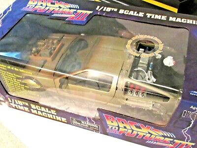 back to the future delorean with lights and sounds new in box  and plastic flame