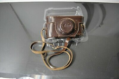 Leica  brown leather,maroon velvet lined camera case, with strap.