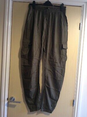 Girls light weight khaki green trousers with elastic waistband age 16 years next