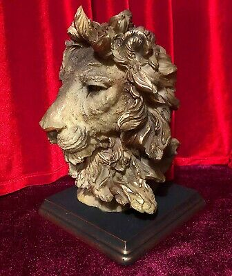 Lion, Leo bust on a stand with a golden mane