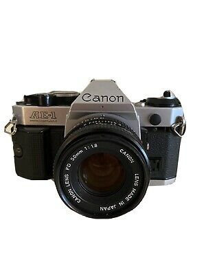Canon AE-1 Program 35mm SLR Film Camera with 50 mm lens Kit and Flash