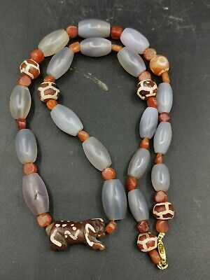 Very nice old bumese carnelian agate beads with red ached lion agate amulet