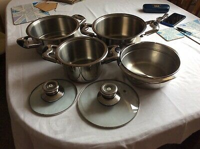 A Stainless Steel steamer Mixing Bowl And Small Sauspan