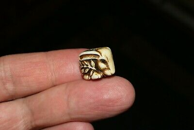 Japanese Antique Hand-Carver of a Netsuke Ojime Bead Rabbit with a twig.