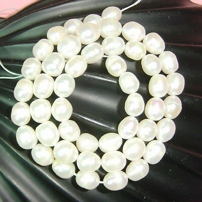 SALE A string of 7-8mm White Rice Freshwater Pearls - 15""