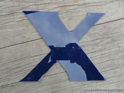 "Funky Blue Plastic ""x"" From A Shop Sign"