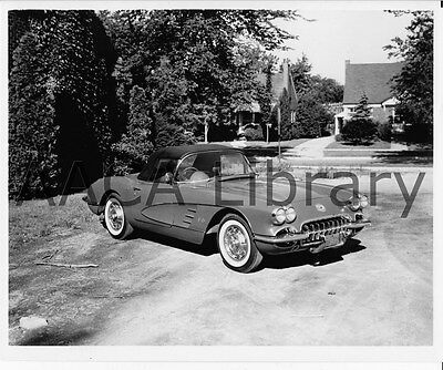 Factory Photo Ref. #35714 1953 Corvette Convertible Coupe by house with dog
