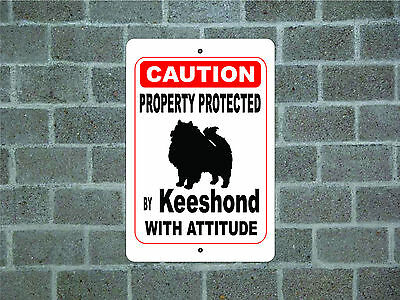 Property protected by Keeshond dog with attitude metal aluminum sign
