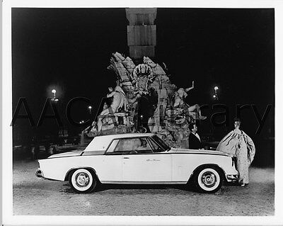 1962 Studebaker Hawk GT in front of fountain, Factory Photo (Ref. #91803)