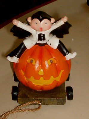 LITTLE DRACULA SITTING ON JACK O'LANTERN WAGON  GREAT FOR HALLOWEEN!   H3