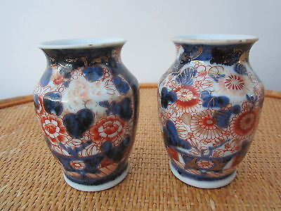 Pair of floral decorated vases in imari colours - possibly Oriental