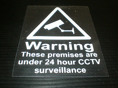 THESE PREMISES ARE UNDER 24 HOUR CCTV SURVEILLANCE signs  . WINDOW STICKERS sign