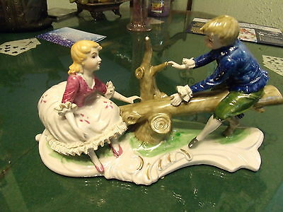 """Vintage 13"""" Porcelain Young Children on Tree See Saw Lace Draped"""