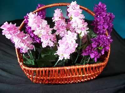 Brown wooden basket with lillacs