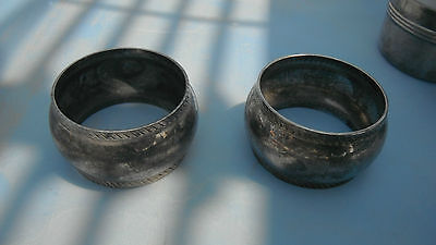 a pair of round silverplated napkin rings