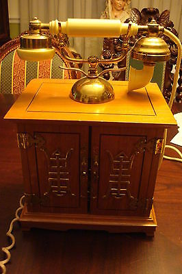 Vintage phone with brass Chinese decorations, with two doors at front[a*4]