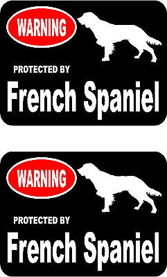 2 protected by French Spaniel dog home car bumper window vinyl decals stickers