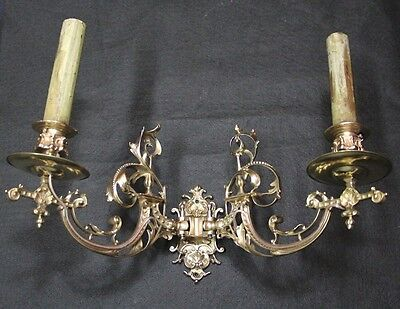 Very interesting antique French swing in out 1 brass sconces