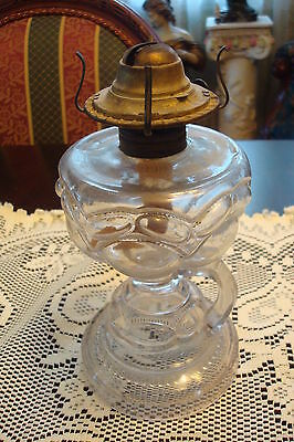 Eagle pressed glass oil lamp with handle, beautiful glass work