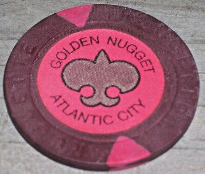 $1 1ST ISSUE ROULETTE CHIP  FROM THE GOLDEN NUGGET IN ATLANTIC CTY