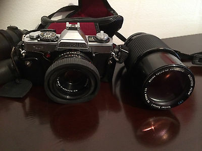 Minolta XG-1 35mm SLR Film Camera with two lenses 90/230 and 70/210.