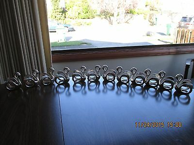 4 Swan Silverplated Napkn Rings by Oneida Silversmths,Wm. A . Rogers