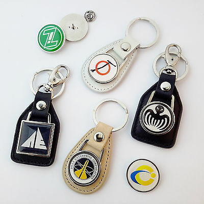 """JAMES BOND """"BAD GUYS"""" Evil Corp KEY RINGS / PIN BADGES - Large Collection NEW"""