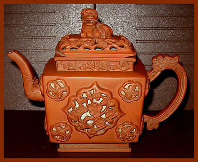 ANTIQUE CHINESE YIXING REDWARE TEAPOT WITH RETICULATED PANELS CIRCA 1700 - 1725