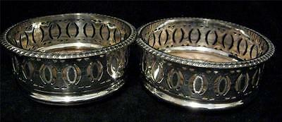 Pair Edwardian Coasters Silver Plated Gadrooned Borders and turned Wood Bases