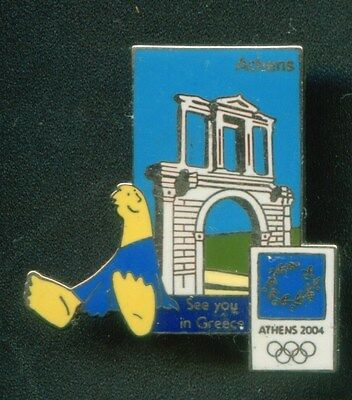 ATHENS 2004. OLYMPIC PIN. MASCOTPHIVOS AT HADRIAN'S ARCH. SEE YOU IN GREECE