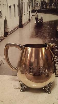 A vintage large epns Decorative Water jug or Milk Jug