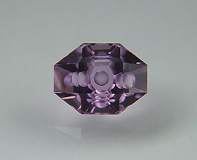 Amethyst. Custom Cut Modified Oval. Flat Facet With Carving. 3.53cts.