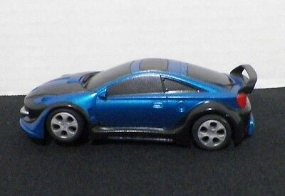 SCX Compact Tuning Slot Car 1/43 Toyota Celica Blue/Black Ground Effects Lights