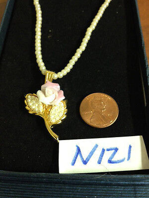 Beautiful necklace of faux pearl with a flower pendant -- new in box