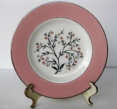 VTG UNMARKED PORCELAIN SAUCER WITH PINK BAND AND FLOWERS IN THE CENTER