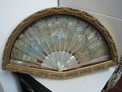 Antique  Fan in Mother pearl It is inside a wooden box with glass on top