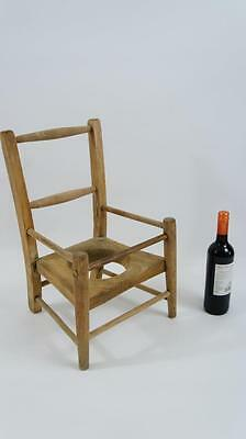 Early 20th century childs Elm & Beech nursing/potty training chair - stripped
