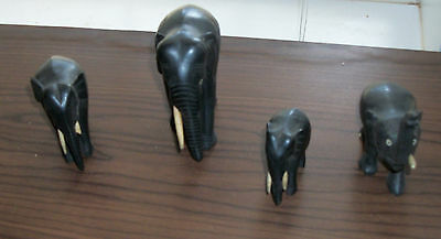 LOT OF 4 VINTAGE SMALL HAND CARVED ELEPHANTS BLACK