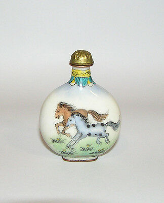 A antique Chinese porcelain and bronze snuff bottle