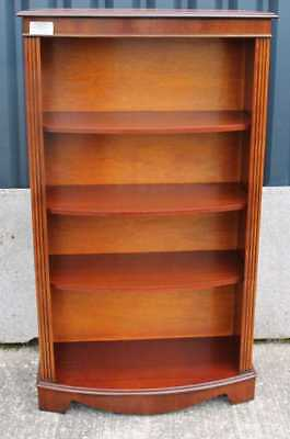 Neat Tall Mahogany Bow shaped open Bookcase with 3 shelves. Carved top cornice.