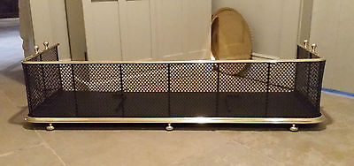Antique large C19th century wire work fireplace fender with brass trim