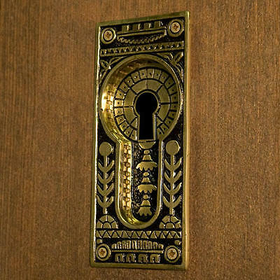 Ornate Recessed Pocket Door Flush Pull with Keyhole in Blackened Brass