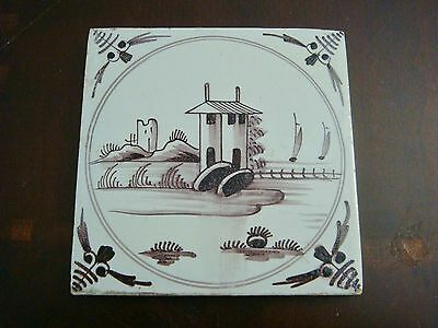 18th century salvaged Delft manganese tile with depictions of country building