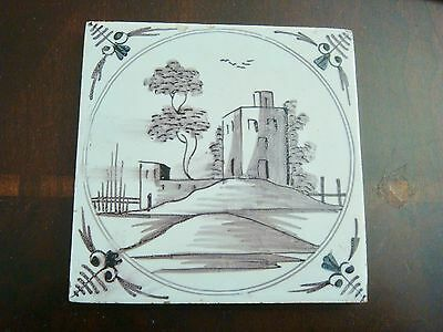 18th century salvaged Delft manganese tile depicting  buildings and trees